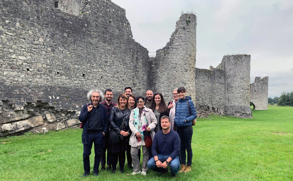 EU Voice 2nd Transnational Partner Meeting attendees on the backdrop of Trim Castle in Trim, Republic of Ireland